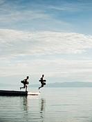 Boys 10_11,12_13 jumping from raft