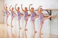 Row of female ballet dancers 6_8 in dance studio