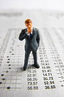 Model businessman on financial figures