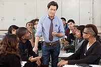 High school students listening to teacher