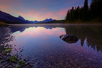 Early morning on a fog covered Maligne Lake in Jasper National Park in the Canadian Rockies during the autumn, Alberta