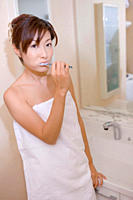 Young woman brushing tooth