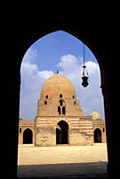 View of Ablutions block and courtyard of Ibn Tulun Mosque through an arch, Cairo, Egypt