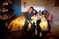 Enrique and Ofelia Viveros hold their one-year-old daughter Alondra, who suffers from endoftalmitis, a fungus infection in the eye, in their modest on...