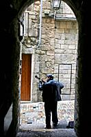 A musician playing the guitar in a alley, Girona, Catalonia, Spain.