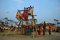 A manual ferriswheel, at a village fair or 'mela', in Banaripara, Barisal, Bangladesh February 26, 2008