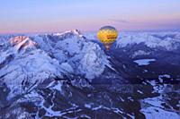 Aerial view of hot_air balloon flying above Alpspitze, Jubilaeumsgrat, Zugspitze, lake Eibsee and Garmisch, Garmisch_Partenkirchen, Wetterstein range,...