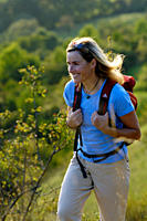 Woman with rucksack hiking at franconian Switzerland, Bavaria, Germany, Europe