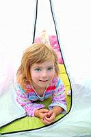 girl in camping tent lying happy on camp tent