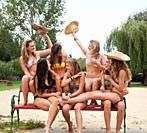 Women in bikinis playing together