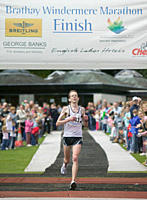 Competitors finishing the Windermere marathon in the Lake District UK