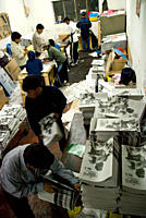 Group of mixed age male Bolivians in a newspaper printing studio view from above, La Paz, Bolivia, South America