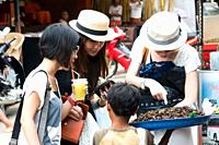 Tourists buying grasshoppers, Siem Reap, Cambodia