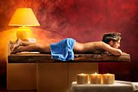 half-naked woman lying in relaxation area