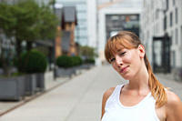 Germany, Cologne, Young woman smiling, portrait