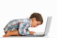 Boy 2_3 using laptop, close up