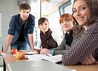 Germany, Leipzig, University students studying together, smiling, portrait