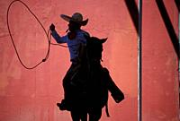 A Mexican charro practices his lasso at the National Charro Championship in Pachuca, Hidalgo State, Mexico. Escaramuzas are similar to US rodeos, wher...