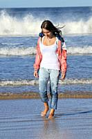 Girl walking at beach, Lossiemouth, Moray, Scotland, United Kingdom, Europe