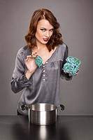 Young woman cooking seaweed pasta