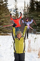 A Family Skiing In The Mountains, Lake Louise, Alberta, Canada