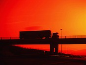 Dublin,Ireland,Truck Driving Over Bridge Silhouetted By Sunset
