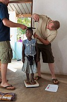 Medical Workers Measuring Height And Weight Of A Young Girl, Manica, Mozambique, Africa