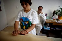 A student gives Reiki using her hands in Mexico City, September 12, 2010  Reiki is a spiritual practice developed in 1922 by Japanese Buddhist Mikao U...