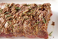 Raw beef with mustard and rosemary
