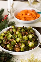 Serving Bowl of Sauteed Brussels Sprouts with Chestnuts, Candied Carrots