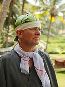 Man with a banana leaf on his head, Ayurvedic treatment, Bethsaida Hermitage near Kovalam, Kerala, southern India, India, Asia