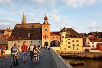 Old Stone Bridge Danube river and Brücktor city gate in Regensburg Bavaria Germany