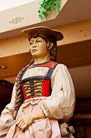Woodcarving of Alpine woman, Romantik Hotel Schweizerhof, Grindelwald, Canton Bern, Switzerland