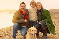 Family with dog on beach. Fall, Autumn