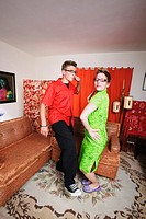 Couple dancing in their living room