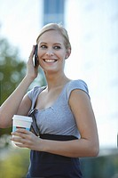 Women with coffee and cellphone