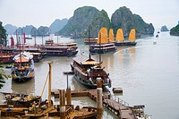Boats and rocky islands in Vietnamese harbor
