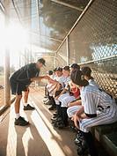 USA, California, Ladera Ranch, coach training little league baseball team 10_11 on dugout