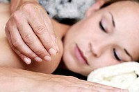 Young woman receiving acupuncture therapy in a natural healing practice