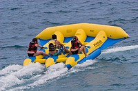 Young people on a fun boat off the beach of the Promenade des Anglais in Nice, Côte d'Azur, Southern France, France, Europe