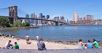 Brooklyn Bridge and skyline of Manhattan seen from Fulton Ferry in Brooklyn, New York, USA