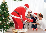 Happy family at christmas evening at home with santa clause
