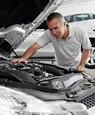 Mechanic repairing car engine