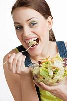 portrait of woman eating salad