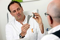 Doctor's surgery, doctor talking to a patient, doctor explaining how an artificial hip joint works