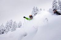 Male free skiers in deep snow, Mayrhofen, Ziller river valley, Tyrol, Austria