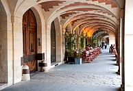 Arcade with a restaurant terrace on the Place des Vosges, Marais district, Paris, Ile de France region, France, Europe