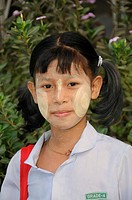 Female pupil with Tanaka paste in her face wearing a school uniform, historic centre of Yangon, Rangoon, Myanmar, Burma, Southeast Asia, Asia