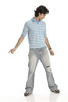 Teenage boy posing as dancing wearing t_shirt and jeans MR 687T