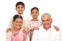 Grandchildren standing behind grandparent kept their hand on their shoulders MR703N,703O,703P, 703Q